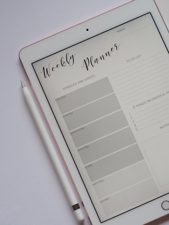 Photo of a tablet displaying a weekly planner template